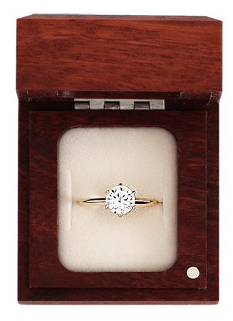 conflict free engagement ring in a wooden ring box