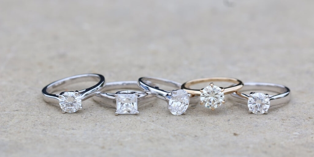 white sapphire engagement rings in various shapes