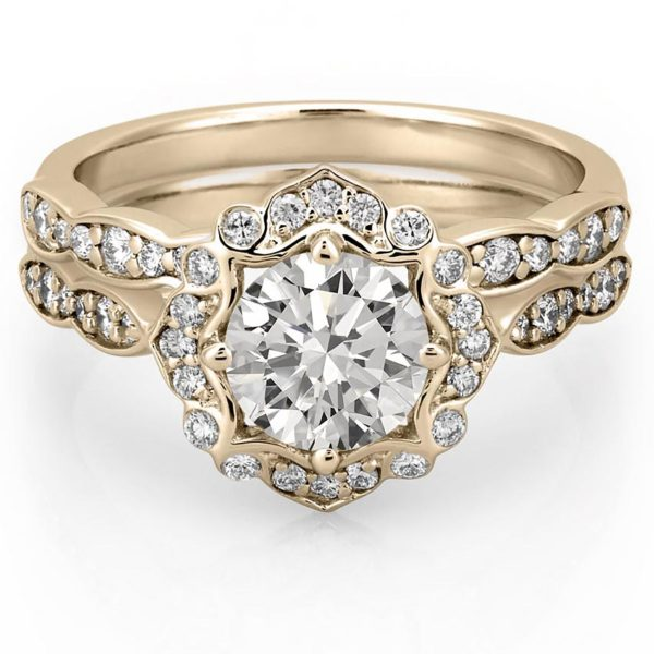 engagement ring set with floral halo in yellow gold