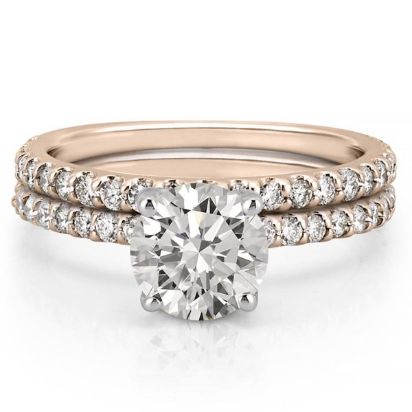 engagement ring set with diamonds on band and basket in rose gold