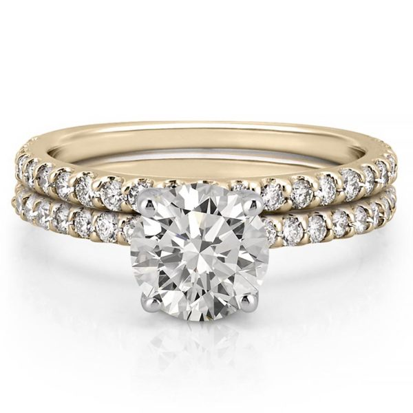 engagement ring set with diamonds on band and basket in yellow gold