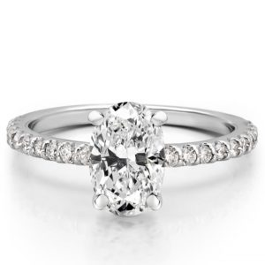 oval engagement ring with diamonds on band and basket in white gold