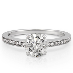Delicate palladium engagement ring with milgrain detail