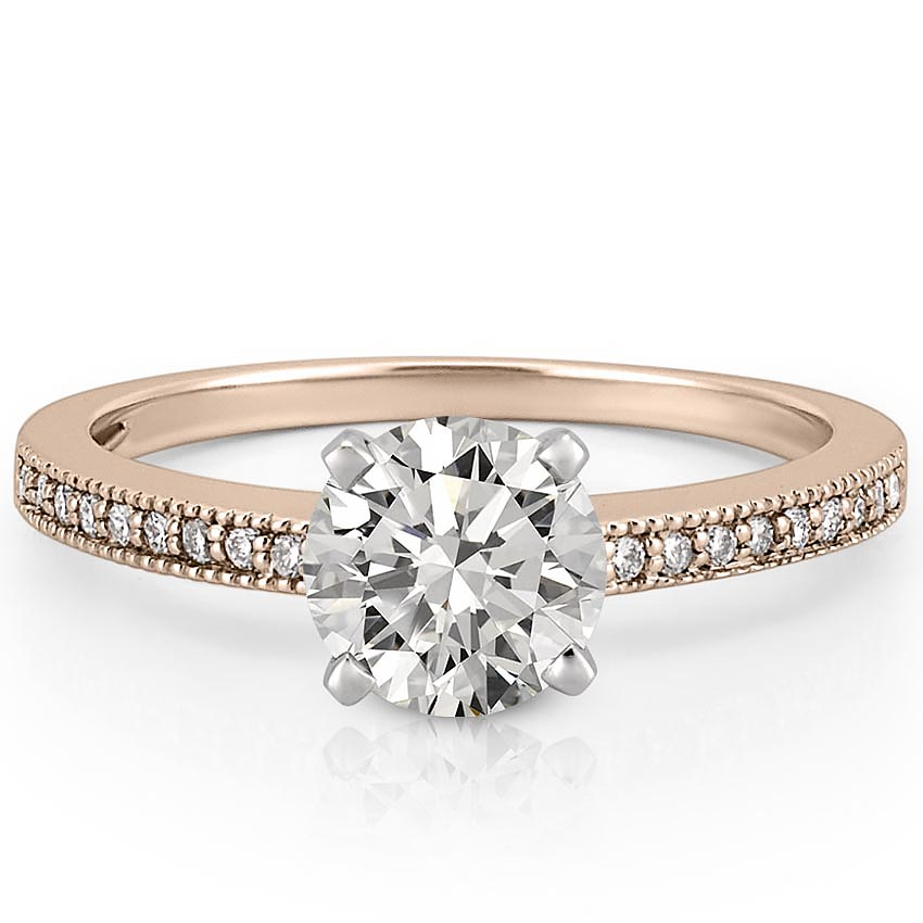 Delicate rose gold engagement ring with milgrain detail