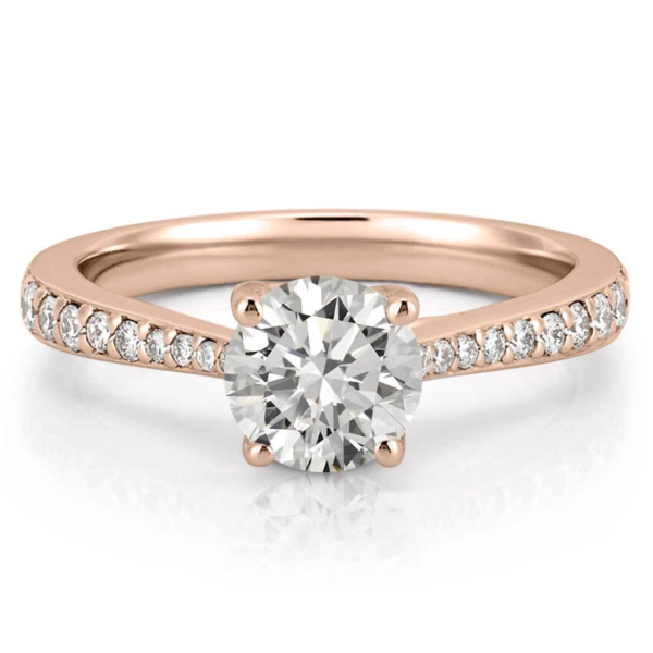 tapered engagement ring with tapering diamonds in rose gold