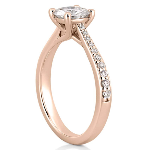 rose gold engagement ring with tapered band and side diamonds