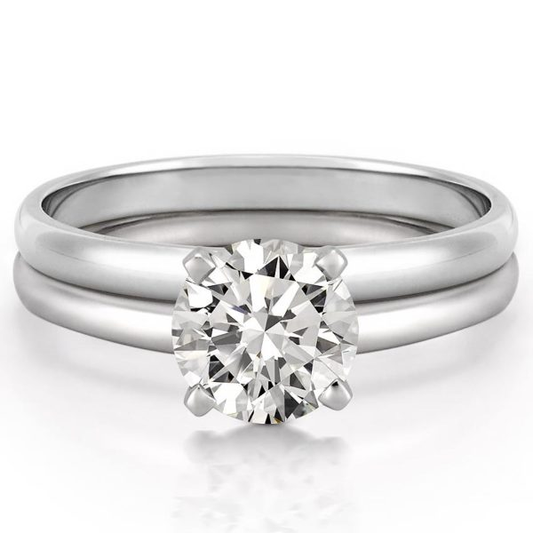 classic 4 prong solitaire engagement ring set in white gold