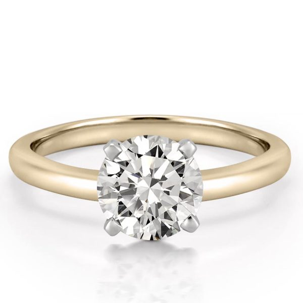 classic yellow gold four prong round cut solitaire
