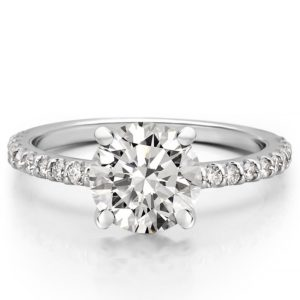 round cut engagement ring with diamonds on band and basket in platinum