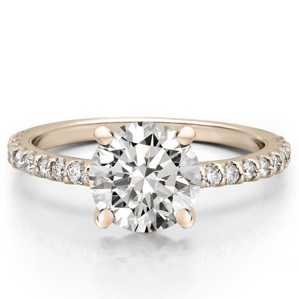 round cut engagement ring with diamonds on band and basket in rose gold