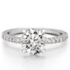 round cut engagement ring with diamonds on band and basket in white gold