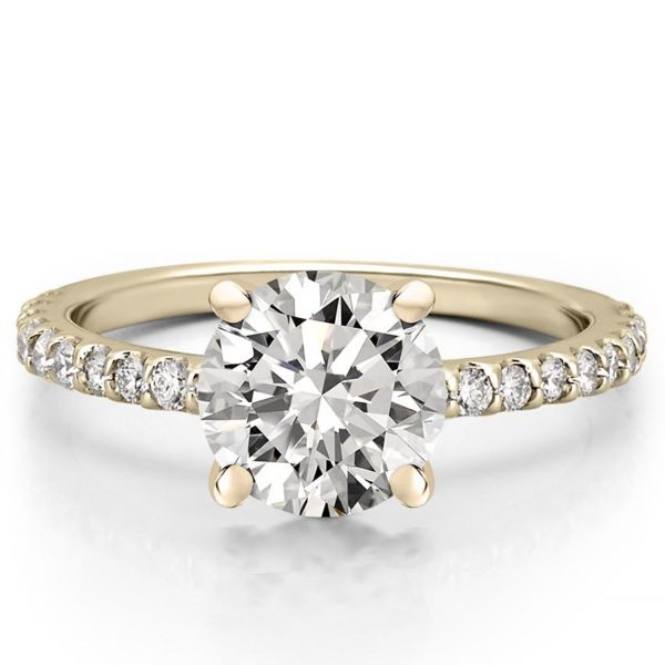 round cut engagement ring with diamonds on band and basket in yellow gold