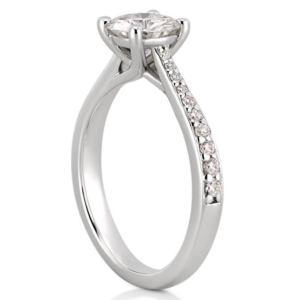 white gold engagement ring with tapered band and side diamonds