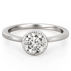 platinum engagement ring featuring a milgrain bezel