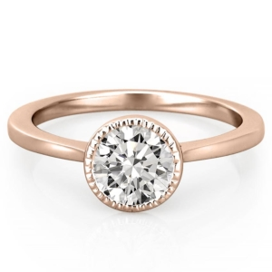 rose gold engagement ring featuring a milgrain bezel