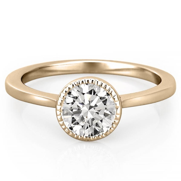 yellow gold engagement ring featuring a milgrain bezel