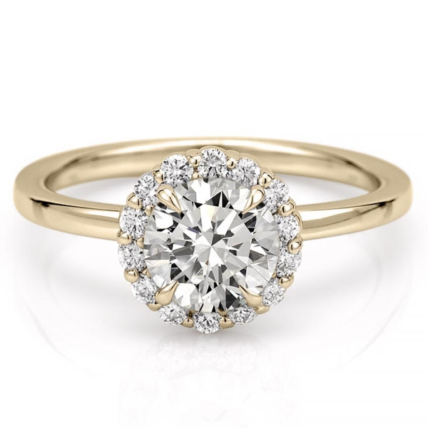 A floral inspired engagement ring in yellow gold