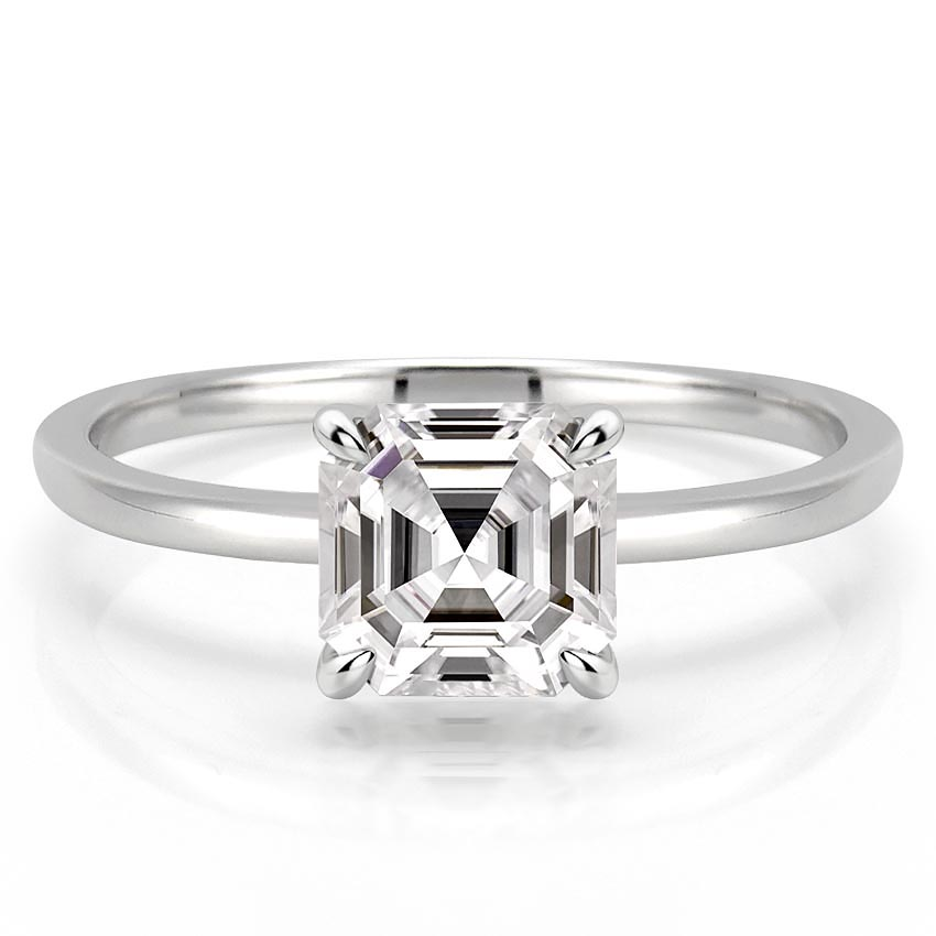 delicate asscher cut engagement ring with claw prongs in white gold