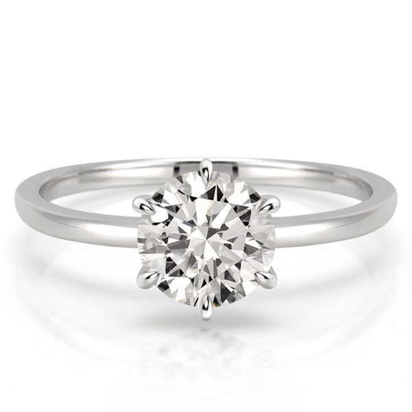 delicate round cut engagement ring with claw prongs in white gold