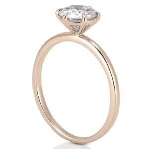 rose gold engagement ring with delicate band and basket head