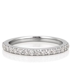 wedding band with round diamonds and shared prongs