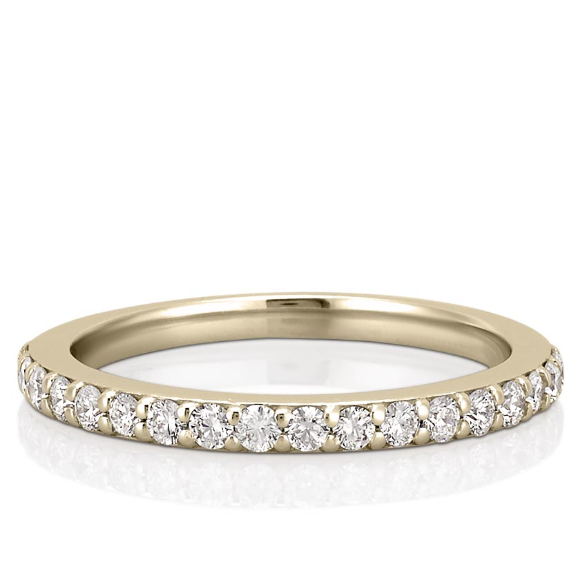 yellow gold wedding band with round diamonds and shared prongs