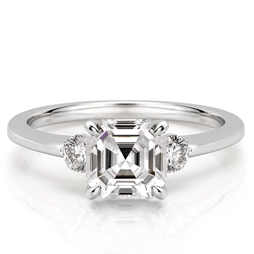 ascher engagement ring with three stones and claw prongs