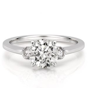 engagement ring with three stones and claw prongs