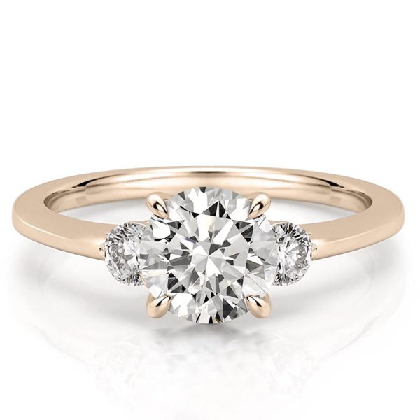 engagement ring with three stones and claw prongs in rose gold