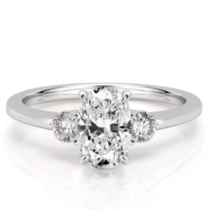 oval engagement ring with three stones and claw prongs