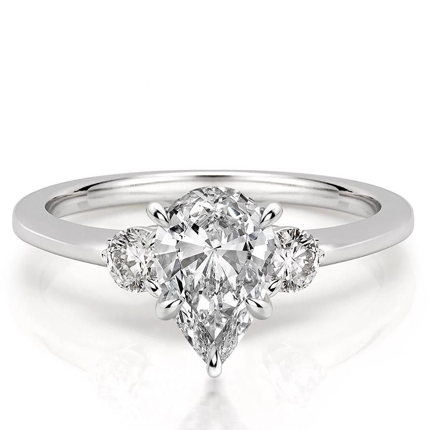 pear engagement ring with three stones and claw prongs
