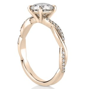 twist band engagement ring with basket in rose gold