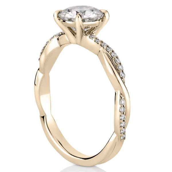 twist band engagement ring with basket in yellow gold