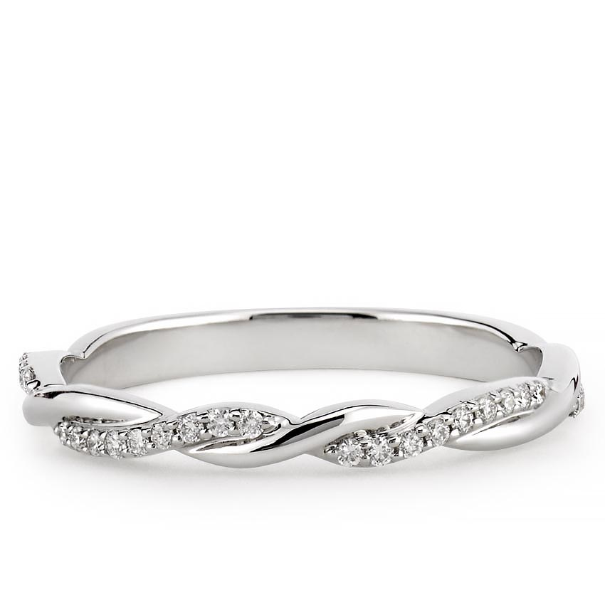 wedding band with twist and pave diamonds