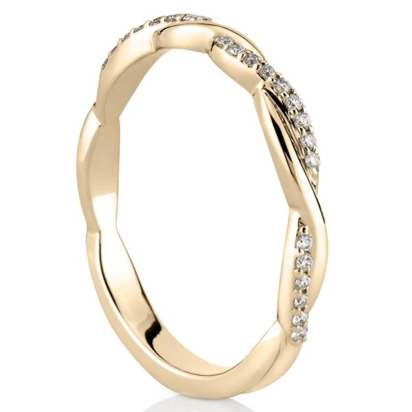 twisted wedding band with pave diamonds in yellow gold