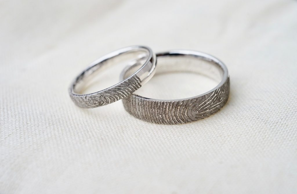 possible promise rings with fingerprint engraved in outside of band in white gold
