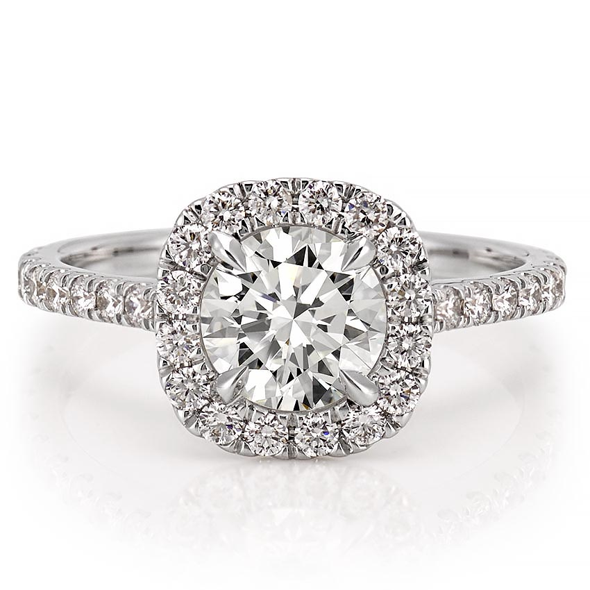 engagement ring with diamond cushion halo and side stones in palladium