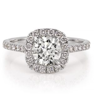 engagement ring with diamond cushion halo and side stones in platinum