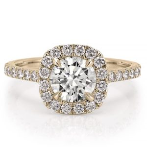 engagement ring with diamond cushion halo and side stones in yellow gold