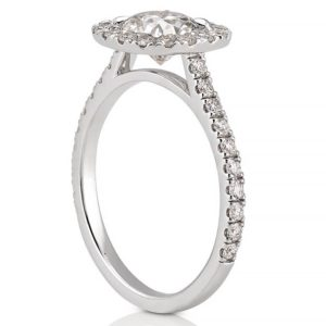 side stone engagement ring with diamond cushion halo