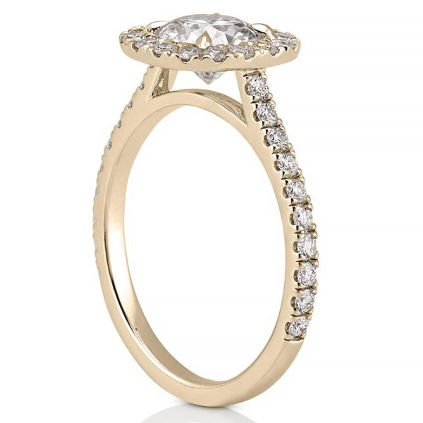 yellow gold side stone engagement ring with diamond cushion halo