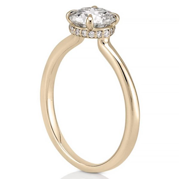 hidden halo engagement ring with claw prongs in yellow gold