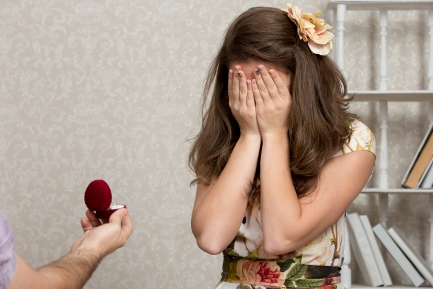 engagement ring box and girl covering eyes during proposal