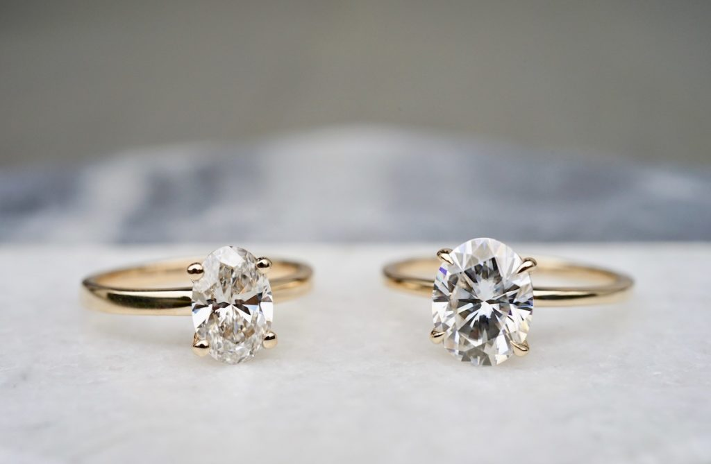engagement rings with oval cut lab diamond and oval moissanite