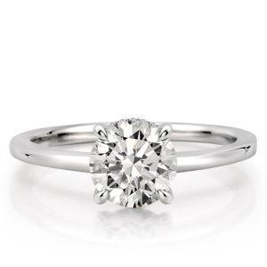 round cut engagement ring with claw prongs and hidden halo in platinum