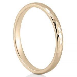 delicate hammered wedding band in yellow gold