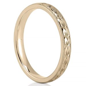hand engraved wedding band in yellow gold