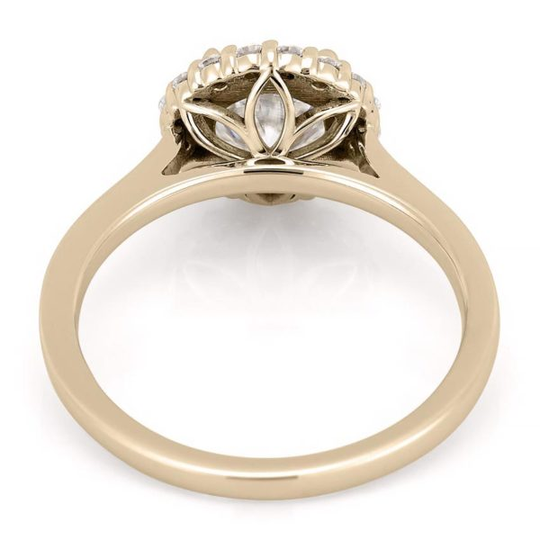 yellow gold engagement ring with leaf basket detail