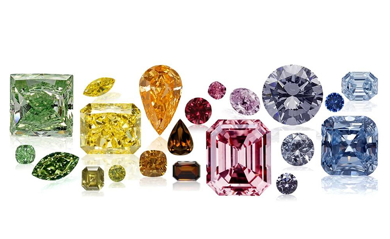various shaped different color diamonds on white surface