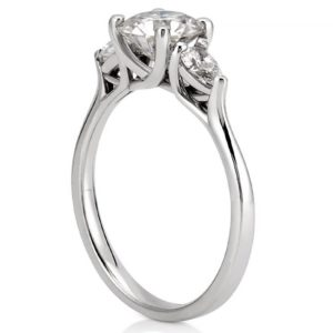 pear side stone engagement ring with trellis setting in white gold